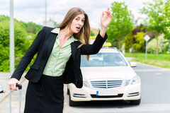 Young businesswoman calls for a taxi Royalty Free Stock Photos