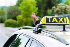 Young businesswoman calls for a taxi Royalty Free Stock Image