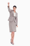 Young businesswoman celebrating success Stock Photo