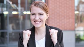 Young Businesswoman Celebrating Success Outdoor. 4k high quality, 4k high quality stock footage