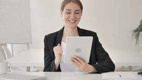 Young Businesswoman Celebrating Success on Tablet stock video footage