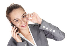 Young businesswoman with cell phone. Isolated on white background Royalty Free Stock Photos