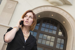 Young Businesswoman On Cell Phone in Front of City Hall Royalty Free Stock Photo
