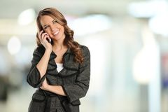 Young businesswoman on the cell phone Royalty Free Stock Photography