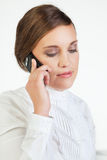 Young businesswoman with cellphone. Head portrait of young smiling businesswoman talking on cellphone Royalty Free Stock Photography