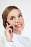 Young businesswoman with cellphone. Head portrait of young smiling businesswoman talking on cellphone Stock Photography