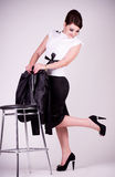 Young Businesswoman with chair Royalty Free Stock Images