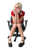 Young businesswoman on a chair Royalty Free Stock Images