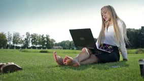 Young businesswoman chatting online using laptop stock footage