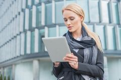 Young businesswoman checking her tablet Royalty Free Stock Photography