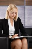 Young businesswoman checking personal calendar Royalty Free Stock Photos