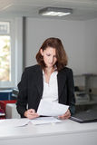 Young businesswoman checks contract Stock Photo
