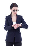 Young businesswoman checks time on her wrist watch isolated on w Stock Images