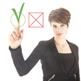 Young businesswoman choosing yes over no isolated Stock Images
