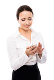 Young businesswoman clicking on a smartphone Royalty Free Stock Photography