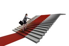 The young businesswoman climbing stairs and red carpet. Young businesswoman climbing stairs and red carpet Stock Photography