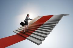 The young businesswoman climbing stairs and red carpet. Young businesswoman climbing stairs and red carpet Royalty Free Stock Image