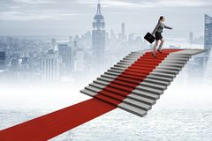 The young businesswoman climbing stairs and red carpet. Young businesswoman climbing stairs and red carpet Royalty Free Stock Photography