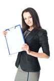 Young businesswoman with a clipboard. Portrait of beautiful young smiling businesswoman showing blank clipboard isolated on white background Royalty Free Stock Images
