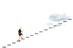Young businesswoman with clipboard walking towards the heights. Full length portrait of a young businesswoman with clipboard walking towards the heights isolated Stock Photo
