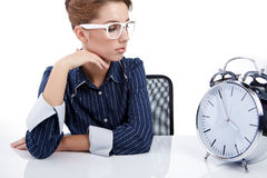 Young businesswoman with a  clock Stock Photo