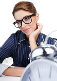Young businesswoman with a  clock Royalty Free Stock Photos
