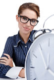 Young businesswoman with a  clock Royalty Free Stock Photography