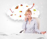 Young businesswoman with cloud in the background containing colo Royalty Free Stock Photo