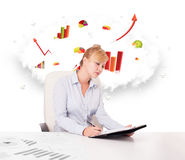 Young businesswoman with cloud in the background containing colo Stock Photography