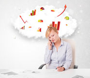 Young businesswoman with cloud in the background containing colo Stock Image