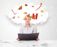 Young businesswoman with cloud in the background containing colo Royalty Free Stock Photography