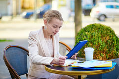 Young businesswoman on a coffee break Stock Image
