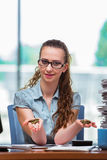 The young businesswoman with coins in the office Royalty Free Stock Images