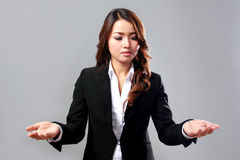 Young businesswoman comparing two items Stock Photos
