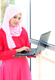 A young businesswoman with a computer. A young muslim businesswoman with a computer Royalty Free Stock Photography
