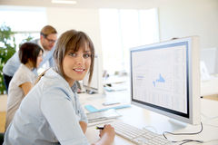 Young businesswoman on computer. Portrait of young businesswoman working in office Stock Photo