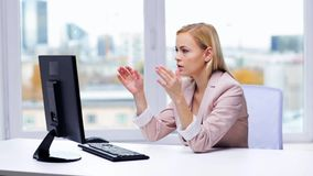 Young businesswoman with computer typing at office stock footage
