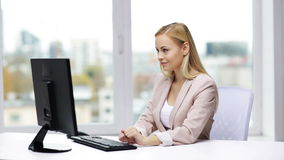 Young businesswoman with computer typing at office stock video footage