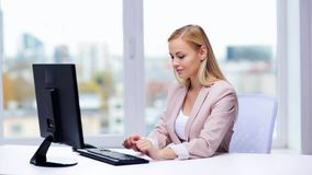 Young businesswoman with computer typing at office stock video