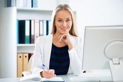 Young businesswoman with computer. In the office Royalty Free Stock Photography