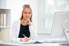 Young businesswoman with computer. In the office Stock Image