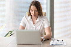 Young businesswoman concentrated on daily tasks stock photo