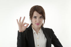 Young businesswoman. Confident young businesswoman showing OK sign stock photo
