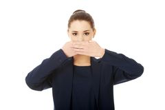 Young businesswoman covering with hand her mouth Stock Photography