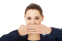 Young businesswoman covering with hand her mouth Royalty Free Stock Images