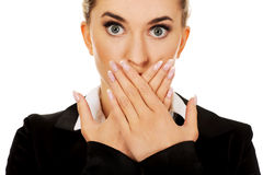 Young businesswoman covering with hand her mouth. Speak no evil concept.  Royalty Free Stock Images