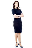 Young businesswoman with crossed arms Royalty Free Stock Image