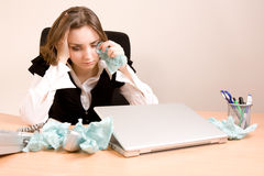 Young businesswoman crying. At the office royalty free stock photo