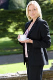 Young businesswoman with cup of tea outdoors, portrait Royalty Free Stock Images
