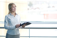 Young businesswoman with day planner in lobby Stock Image